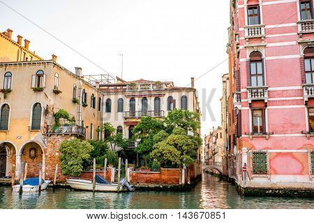 Venice cityscape view on colorful buildings and boats on Grand canal at the sunrise