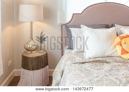 Kid's Bedroom Design With Colorful Dolls And Set Of Pillow