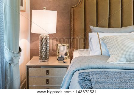 Luxury Bedroom With Set Of Pillows On Bed And White Lamp