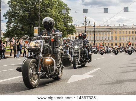 St. Petersburg, Russia - 12 August, Driving through a group of motorcyclists, 12 August, 2016. The annual parade of Harley Davidson in the squares and streets of St. Petersburg.