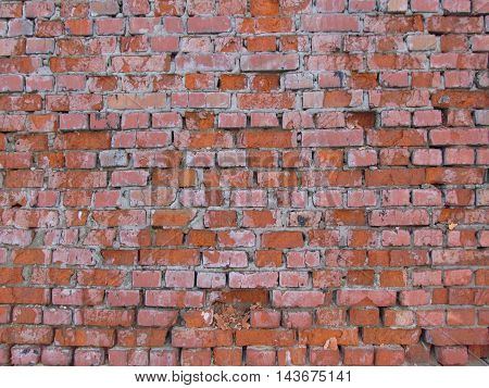 Old red brick cracked wall texture background