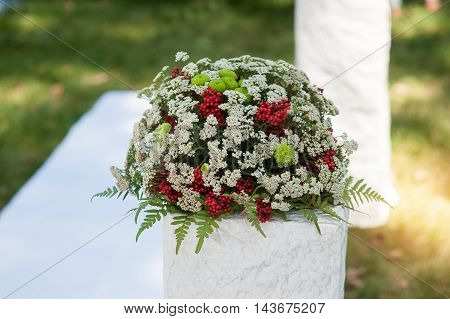 Wedding bouquet of red roses flowers on antique dressing table.