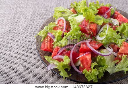 Side View On A Plate With Fresh Salad Of Raw Vegetables Closeup