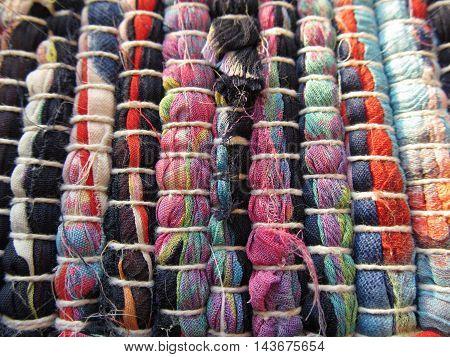 Bright cotton canvas textile rug texture close-up