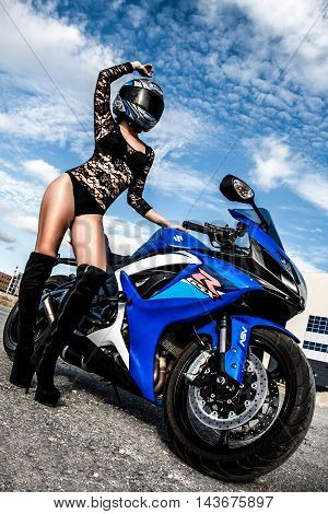 Sexy Young Woman And Suzuki Gsx-r750