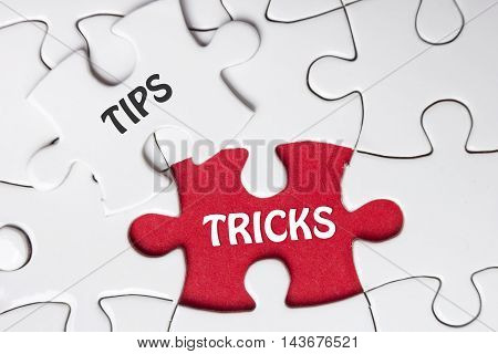 Tips and Tricks. Missing Piece Jigsaw Puzzle with word.