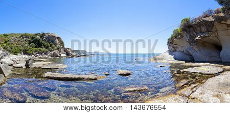 Panorama Of Blue Sea And The Rocky Reef In The West Coast Sardinia Italy