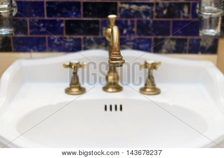 turned off bronzy metal tap of retro design