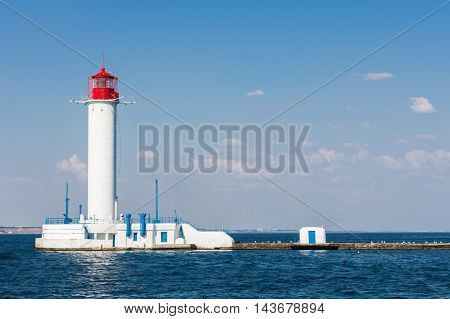 Lighthouse on the sea. Sunny summer day