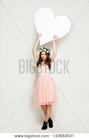 Fashion Woman holding Big White Heart Banner. Sale Background