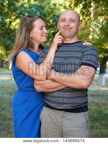 woman touch man face, happy couple posing, romantic people concept, summer season, emotion and feeling
