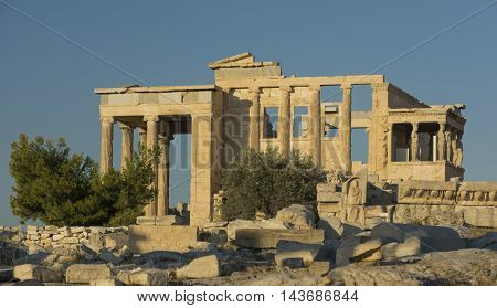 the temple of Athena and Poseidon on the Acropolis in Athens on a Sunny summer day on the background of blue sky