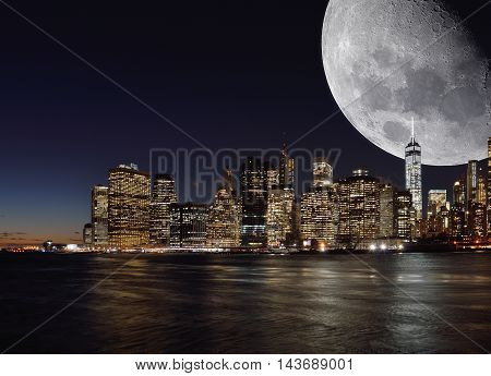 New York City skyline at night with Moon on the sky.