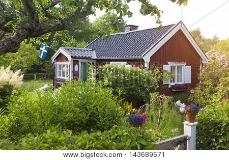 summer cottage with flower in the garden in sweden