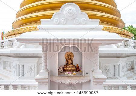 Buddhist dagoba (stupa) close up in Golden Temple. Dambulla Sri Lanka