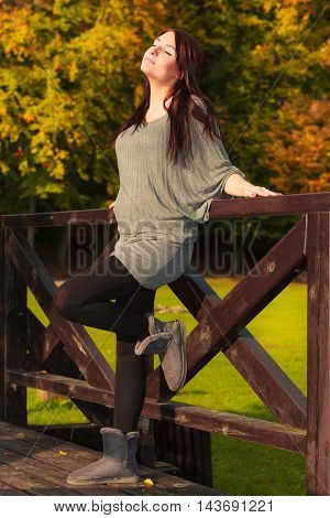 Pregnancy motherhood and happiness concept. Relaxed calm pregnant woman walking outside in autumn park