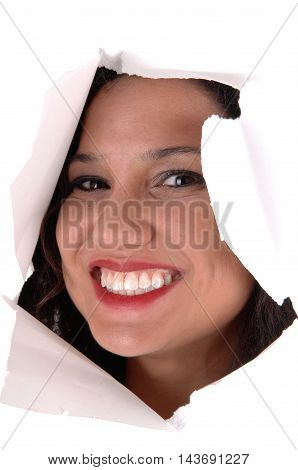 A lovely woman looking through a hole in a paper smiling and happy isolated for white background.