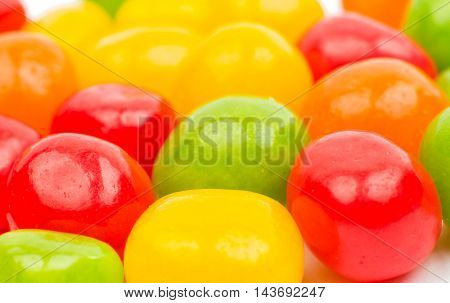 colored jelly beans on a white background