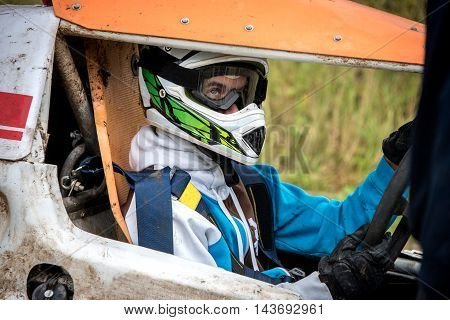 Man behind the wheel of a race car