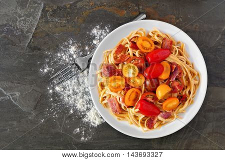 Creamy Butternut Squash Pasta With Bacon And Cherry Tomatoes, Overhead View On Slate