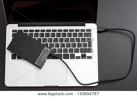 External hard disk over laptop keyboard, close-up