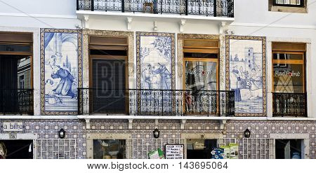 LISBON, PORTUGAL - September 30, 2015: Tile panels with the image Saint Anthony, the patron saint of Lisbon, can be found on the streets of Lisbon. Here, on September 30, 2015 in Lisbon, Portugal
