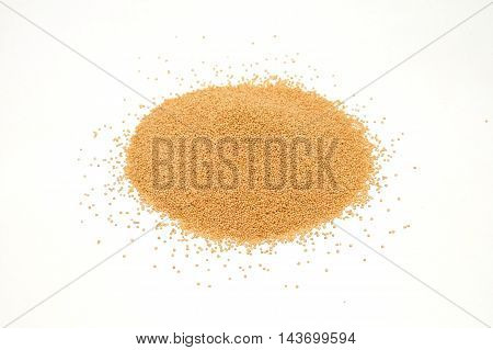 Amaranth grains pile isolated on white background
