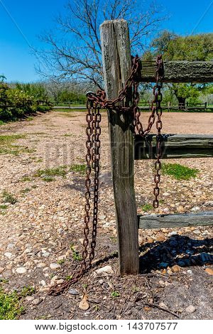 Old Texas Wooden Rail Fence with Rusty Old Chain.  Old West Symbols.