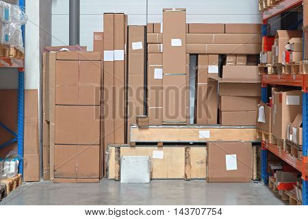 Shipping Packages Boxes in Distribution Center Warehouse