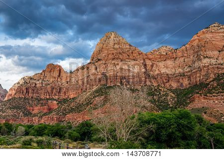 Stormy Clouds, Beautiful Mountain Tops and Rock Formations in Zion National Park Utah.