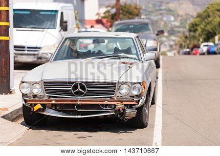 Laguna Beach, CA, USA - August 20, 2016: A run down classic Mercedes benz pagoda sports car on the street in Laguna Beach, California.