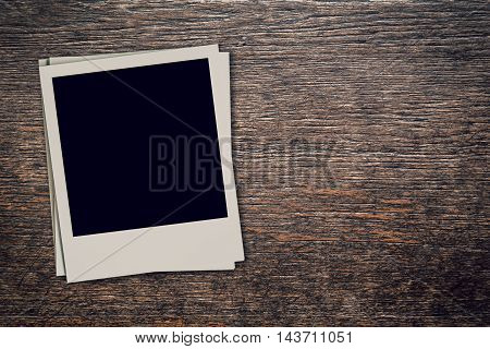 Vintage Blank Photo Frame On Wood Background With Space