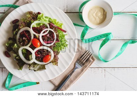Close up of fresh hydroponic salad on white wooden table