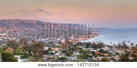 Blue sky over the coastline of Laguna Beach, California, in summer on a clear day with the ocean near sunset.