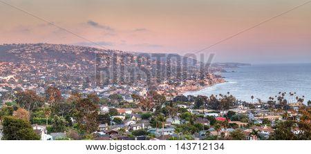 Blue sky over the coastline of Laguna Beach, California, in summer on a clear day with the ocean near sunset.