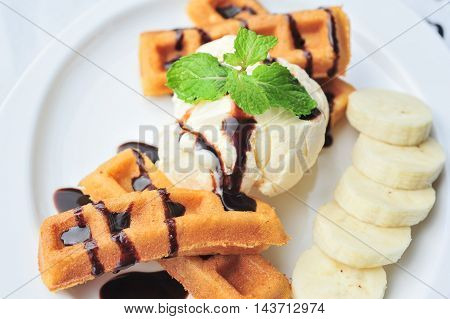 vanilla ice cream waffle with bananas close up and detail