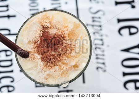 Ice cappuccino coffee with whipped cream close up and detail
