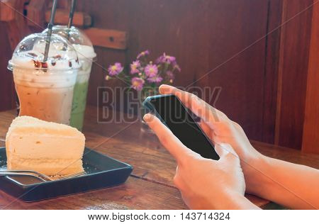 Closeup woman using smartphone in coffee shop, stock photo