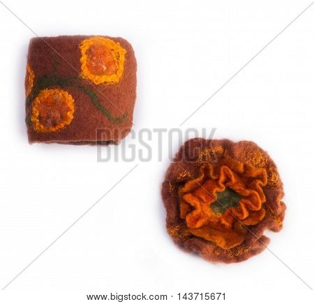 Brooch made of felt wool cuff on a white background