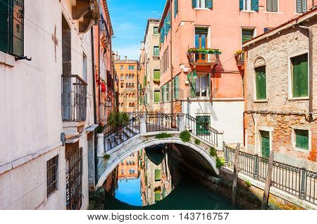 Scenic canal with bridge and colorful buildings in Venice Italy