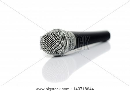 Microphone close up on a white background .