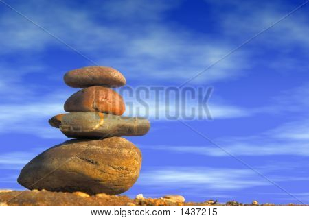 Stack Of Pebbles Against Blue Cloudy Sky, Zen