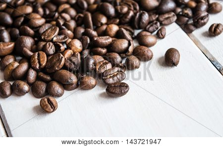 Coffee beans with anis on the table.