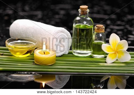 Spa still life with of beautiful frangipani and oil, soap and bamboo grove