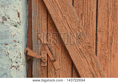 Old wooden door and metal hook. the white balance shifted