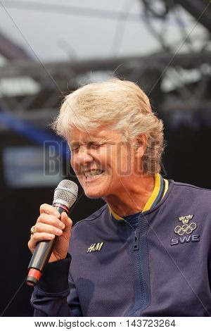 STOCKHOLM SWEDEN - AUG 21 2016: Swedish female soccer team captain Pia Sundhage singing when the swedish olympic athletes are celebrated in Kungstradgarden Stockholm Sweden August 212016