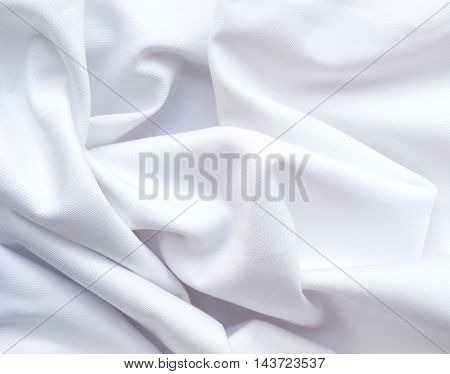 Wavy, white cloth or textile, textile background with copy space.