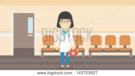An asian female doctor holding first aid box. Doctor in uniform with first aid kit standing in the hospital corridor. Vector flat design illustration. Horizontal layout.
