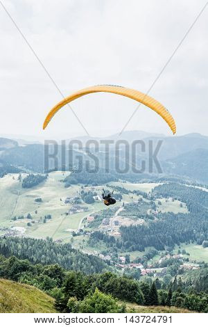 Paragliding Donovaly mountains scene Slovak republic. Leisure activities. Vertical composition. Beauty in nature. Adrenaline sport.