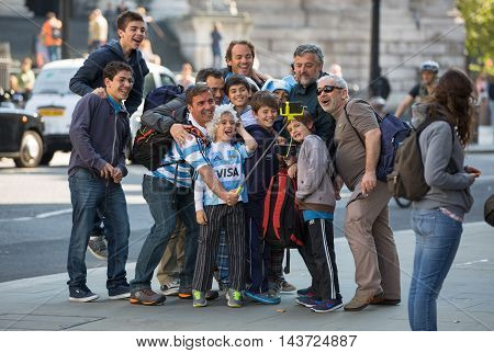 LONDON, UK - SEPTEMBER 20, 2015: Family making a selfie and the London's street. Boy's day out